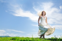 happy young beautiful bride after wedding ceremony event have fun outdoor on meadow at sunset